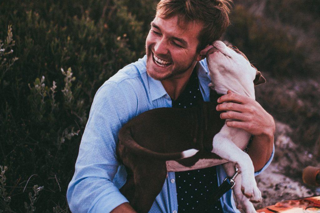 man bonding with his dog